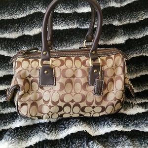 Coach handbag, leather piping